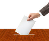 Hand with ballot and box Stock Photos