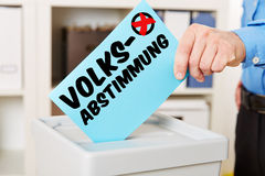 Hand with ballot paper for referendum Stock Image