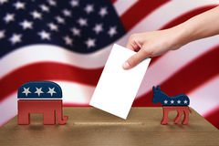 Hand with ballot and wooden box, America Royalty Free Stock Photography