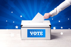 Hand with ballot and wooden box Royalty Free Stock Photos