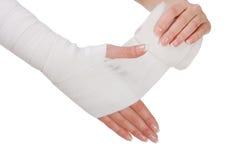 Hand bandaging by elastic bandage. Closeup. isolated Royalty Free Stock Photography