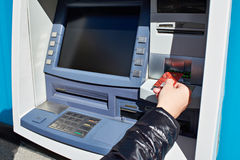 Hand with bank card at ATM. Hand with a bank card at the ATM stock image