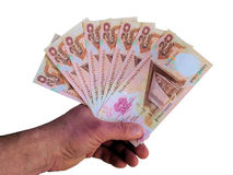 Hand with banknotes of  Papua New Guinea. Royalty Free Stock Images