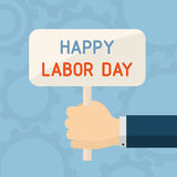 Hand with banner of labor day Stock Photo