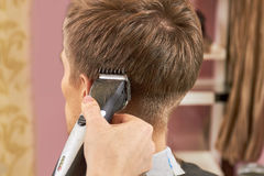 Hand of barber, hair clipper. Royalty Free Stock Images