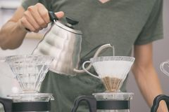 Hand of barista drip coffee, Barista pouring hot water on coffee ground with filter royalty free stock photos