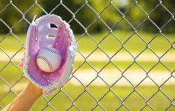 Hand of Baseball Player with Pink Glove and Ball Royalty Free Stock Image