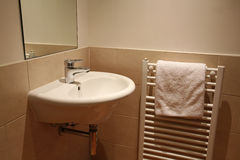 Hand Basin. And towel in modern bathroom Stock Photography