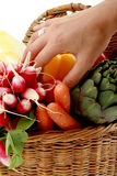 Hand in a basket of vegetables Royalty Free Stock Photo