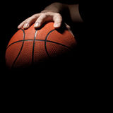 Hand and basketball ball Stock Image