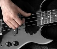 Hand on bass guitar Stock Image