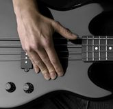 Hand on bass guitar Royalty Free Stock Photos