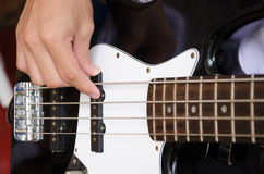 Hand for bass guitar Stock Photo