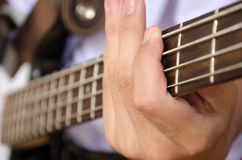 Hand for bass guitar Stock Image
