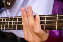 Hand for bass guitar Stock Photos