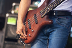 Hand of bass guitarist in concert Royalty Free Stock Photography