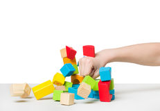Hand beating house made of color wooden blocks Royalty Free Stock Photos