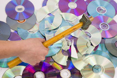 Hand beating out cd royalty free stock photo