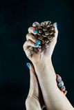 Hand with beautiful nails on black background. Hands with beautiful nails on a black background with decor Stock Image