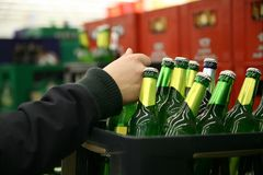 Hand on beer bottle Stock Image