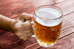Hand with beer glass Stock Photo