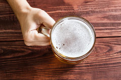 Hand with beer glass Stock Photography
