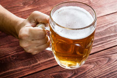 Hand with beer glass Royalty Free Stock Photo