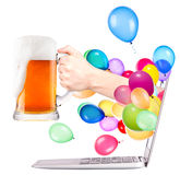 Hand with beer and  laptop Royalty Free Stock Images