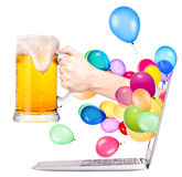 Hand with beer and  laptop Stock Images