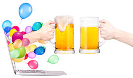 Hand with beer and  laptop Stock Photo