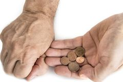 Hand of beggar man with nickels on the white. Hand of beggar man with nickels on the white stock image