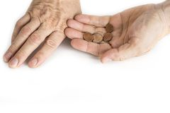 Hand of beggar man with nickels on the white. stock images