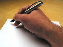 Hand beginning to write Stock Photo