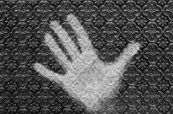 Hand behind the glass Royalty Free Stock Photography