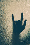 Hand behind the glass Royalty Free Stock Photo