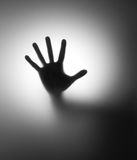 Hand behind matted glass Royalty Free Stock Photo