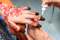 Hand being decorated with henna Royalty Free Stock Photos