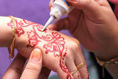 Hand being decorated with henna Stock Images