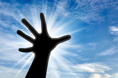 Hand believer reaches for the sky Royalty Free Stock Images