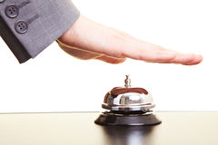 Hand on bell Stock Images