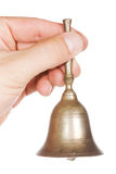 Hand with bell Stock Image