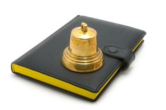 Hand bell and the bible. On a white background royalty free stock photo