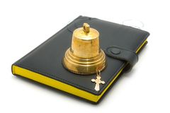 Hand bell, dagger and the bible. On a white background royalty free stock image