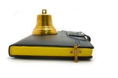 Hand bell, dagger and the bible. On a white background royalty free stock photography