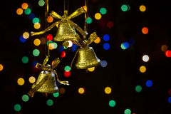 Hand bells. On a black background with light stains Stock Photo