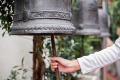 Bells in large temples are for the devotion. Hand Bells in large temples are for the devotion stock image
