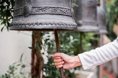 Bells in large temples are for the devotion. Hand Bells in large temples are for the devotion stock photography