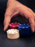 Hand betting all in with poker chips, retro color look Stock Photos