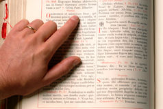 Hand and bible Stock Photos