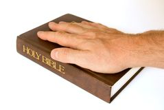 Hand on a Bible Stock Photo